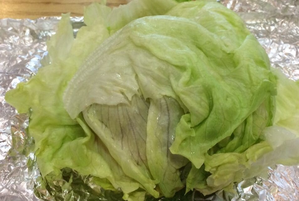 E. coli is a communicable disease that traditionally follows the fecal-oral route in infecting people, meaning that the tainted romaine lettuce has been contaminated with feces.