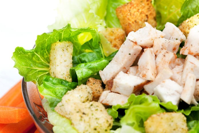 A Chicken Caesar Salad with triple washed salad