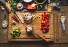Copped Vegetables Ingredients For Tasty Vegetarian Stir Fry Dishes On Wooden Cutting Board With Knife And Chopsticks Top View Asian Cuisine Healthy