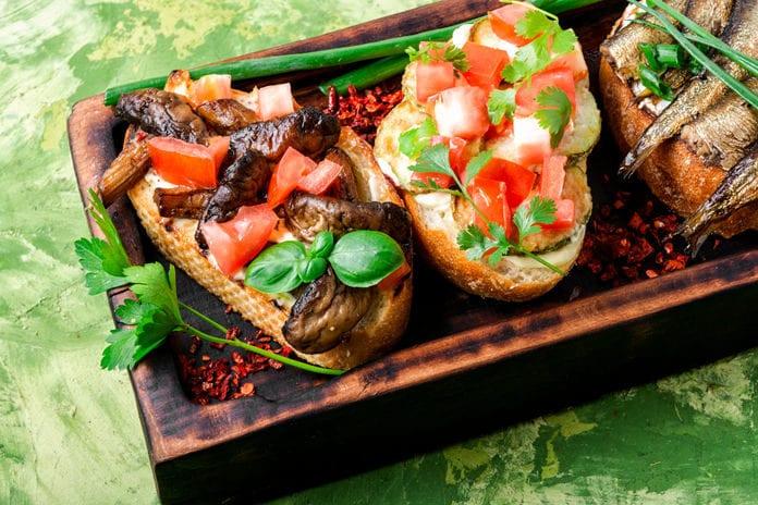 Traditional Italian Bruschetta On Wooden Cutting Board Traditional Italian Bruschetta